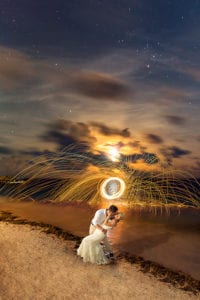 https://www.buysparklers.com/wp-content/uploads/2018/10/Bride-and-Groom-Long-Exposure-Sparklers-Destination-Beach-Wedding-Aldabella-Photography-200x300.jpg